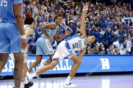 Duke forward Justin Robinson (50) reacts following a three-point basket against North Carolina during the second half of an NCAA college basketball game in Durham, N.C