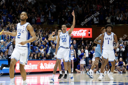 Stock Image of Duke forward Justin Robinson (50) reacts following a basket against North Carolina with guard Cassius Stanley (2) and center Vernon Carey Jr. (1) during the second half of an NCAA college basketball game in Durham, N.C