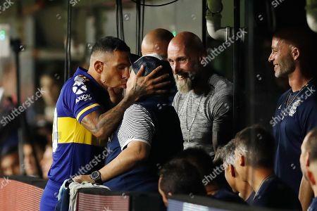 Boca Juniors' Carlos Tevez kisses Gimnasia y Esgrima 's coach Diego Maradona prior to an Argentina's soccer league match at La Bombonera stadium in Buenos Aires, Argentina