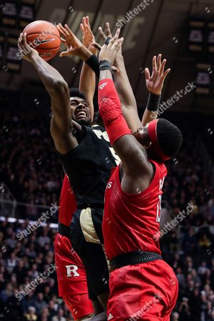 Purdue forward Trevion Williams (50) shoots over Rutgers forward Shaq Carter (13) during the second half of an NCAA college basketball game in West Lafayette, Ind.,. Rutgers defeated Purdue 71-68 in overtime