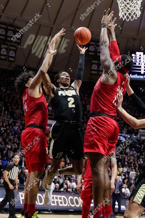 Purdue guard Eric Hunter Jr. (2) shoots between Rutgers forward Shaq Carter (13) and guard Ron Harper Jr. (24) during the second half of an NCAA college basketball game in West Lafayette, Ind.,. Rutgers defeated Purdue 71-68 in overtime