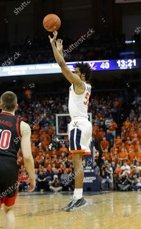 Virginia Cavaliers Guard (53) Tomas Woldetensae makes a three point shot during a NCAA Men's Basketball game between the Louisville Cardinals and the University of Virginia Cavaliers at John Paul Jones Arena in Charlottesville, VA
