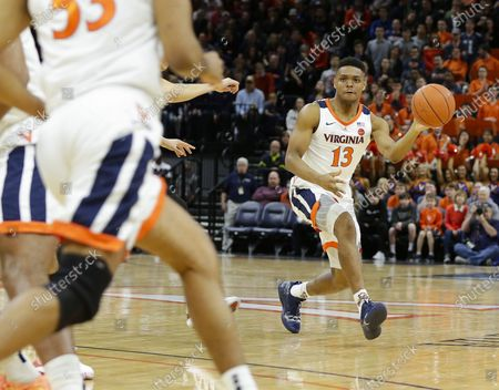 Virginia Cavaliers Guard (13) Casey Morsell passes the ball during a NCAA Men's Basketball game between the Louisville Cardinals and the University of Virginia Cavaliers at John Paul Jones Arena in Charlottesville, VA