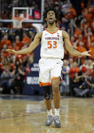Virginia Cavaliers Guard (53) Tomas Woldetensae celebrates a three point basket during a NCAA Men's Basketball game between the Louisville Cardinals and the University of Virginia Cavaliers at John Paul Jones Arena in Charlottesville, VA