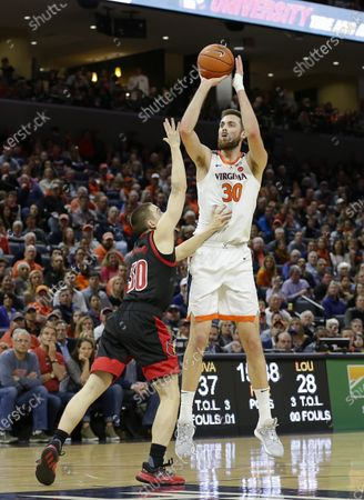 Virginia Cavaliers Forward (30) Jay Huff takes a shot over Louisville Cardinals Guard (30) Ryan McMahon during a NCAA Men's Basketball game between the Louisville Cardinals and the University of Virginia Cavaliers at John Paul Jones Arena in Charlottesville, VA