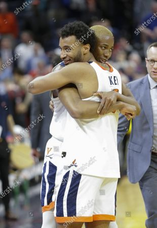 Stock Picture of Virginia Cavaliers Guard (2) Braxton Key and Virginia Cavaliers Forward (25) Mamadi Diakite celebrate their victory after a NCAA Men's Basketball game between the Louisville Cardinals and the University of Virginia Cavaliers at John Paul Jones Arena in Charlottesville, VA