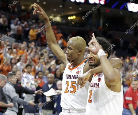 Stock Image of Virginia Cavaliers Guard (2) Braxton Key and Virginia Cavaliers Forward (25) Mamadi Diakite celebrate their victory after a NCAA Men's Basketball game between the Louisville Cardinals and the University of Virginia Cavaliers at John Paul Jones Arena in Charlottesville, VA