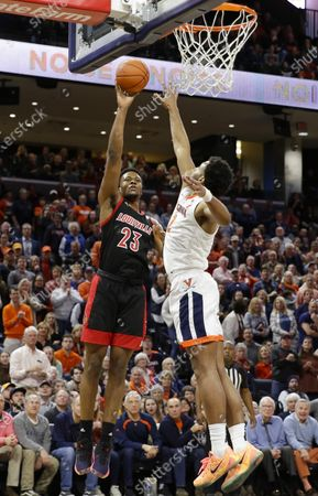Louisville Cardinals Center (23) Steven Enoch puts up a shot over the outstretched arm of Virginia Cavaliers Guard (2) Braxton Key during a NCAA Men's Basketball game between the Louisville Cardinals and the University of Virginia Cavaliers at John Paul Jones Arena in Charlottesville, VA