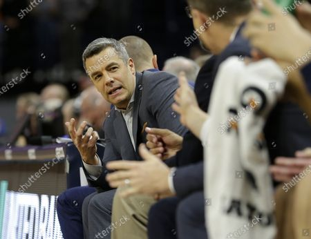 Virginia Cavaliers Head Coach Tony Bennett talks with his assistant coaches during a NCAA Men's Basketball game between the Louisville Cardinals and the University of Virginia Cavaliers at John Paul Jones Arena in Charlottesville, VA