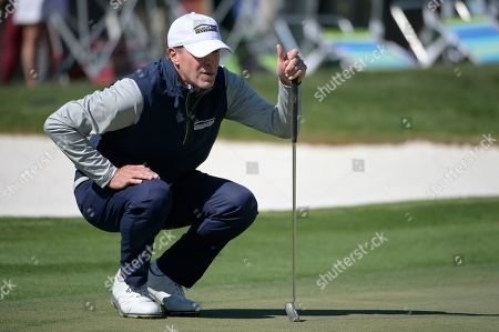 Stock Photo of Steven Stricker lines up a putt on the eighth green during the third round of the Arnold Palmer Invitational golf tournament, in Orlando, Fla