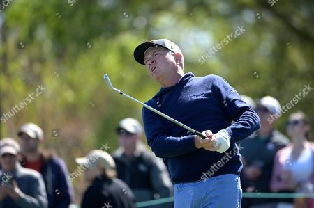 Davis Love III watches his tee shot on the seventh hole during the third round of the Arnold Palmer Invitational golf tournament, in Orlando, Fla