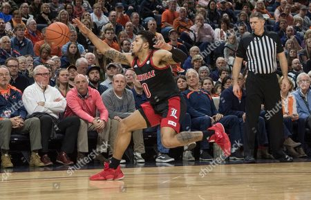 Louisville guard Lamarr Kimble runs down a rebound against Virginia during the second half of an NCAA college basketball game in Charlottesville, Va