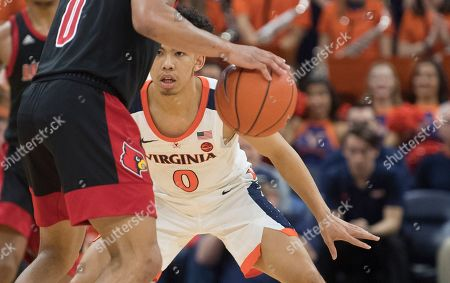 Virginia guard Kihei Clark (0) stays close to Louisville guard Lamar Kimble (0) during the second half of an NCAA college basketball game in Charlottesville, Va