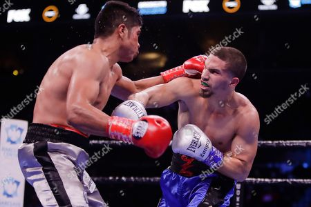 Zachary Ochoa, right, punches Mexico's Angel Sarinana during the third round of a super lightweight boxing match, in New York. Ochoa won the fight
