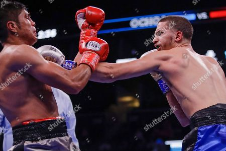 Zachary Ochoa, right, punches Mexico's Angel Sarinana during the eighth round of a super lightweight boxing match, in New York. Ochoa won the fight