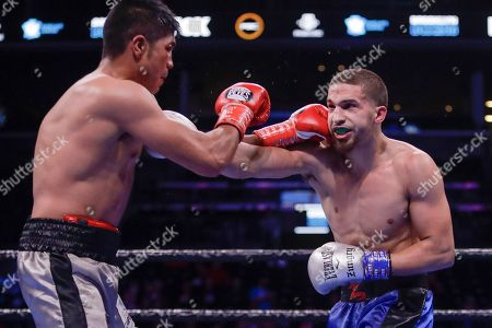 Mexico's Angel Sarinana, left, punches Zachary Ochoa during the eighth round of a super lightweight boxing match, in New York. Ochoa won the fight
