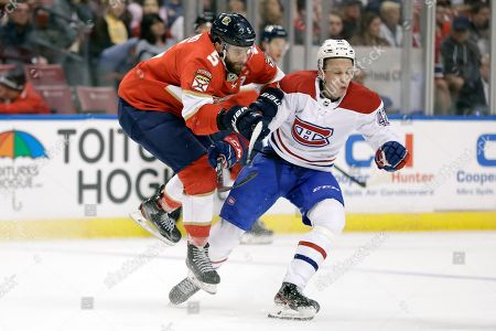 Stock Photo of Aaron Ekblad, Lukas Vejdemo. Florida Panthers defenseman Aaron Ekblad (5) and Montreal Canadiens center Lukas Vejdemo (42) collide during the first period of an NHL hockey game, in Sunrise, Fla