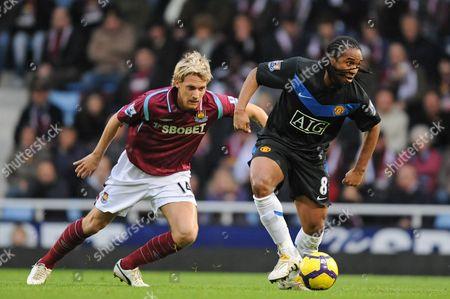 Anderson Luis de Abreu Oliveira  of Manchester United breaks away from Radoslav Kovac of West Ham United