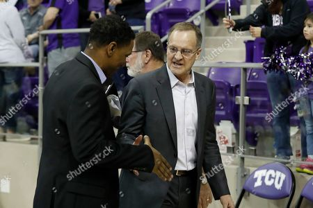 Oklahoma head coach Lon Kruger, right, shakes hands with a member of his staff after their NCAA college basketball game against TCU in Fort Worth, Texas