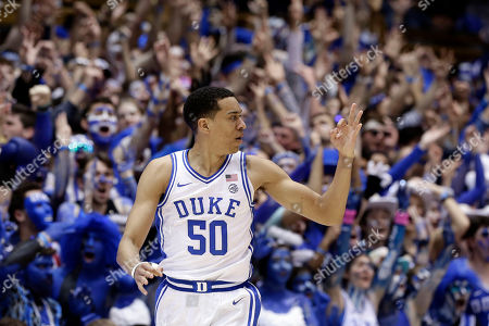 Duke forward Justin Robinson (50) reacts following a basket against North Carolina during the first half of an NCAA college basketball game in Durham, N.C
