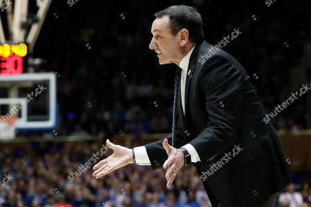 Duke head coach Mike Krzyzewski reacts during the first half of an NCAA college basketball game against North Carolina in Durham, N.C
