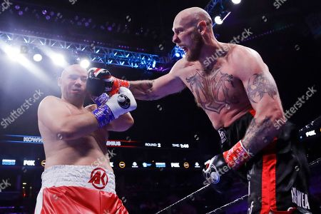 Sweden's Robert Helenius, right, punches Poland's Adam Kownacki during the second round of a heavyweight boxing match, in New York. Helenius stopped Kownacki in the fourth round