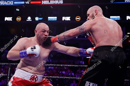 Sweden's Robert Helenius, right, punches Poland's Adam Kownacki during the third round of a heavyweight boxing match, in New York. Helenius stopped Kownacki in the fourth round