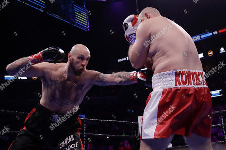 Sweden's Robert Helenius, left, punches Poland's Adam Kownacki during the first round of a heavyweight boxing match, in New York. Helenius stopped Kownacki in the fourth round