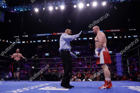 Stock Image of The referee counts for Poland's Adam Kownacki after he was knocked down during the fourth round of a heavyweight boxing match against Sweden's Robert Helenius, in New York. Helenius stopped Kownacki in the fourth round