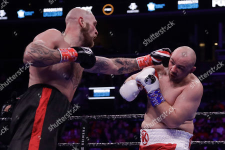 Sweden's Robert Helenius, left, punches Poland's Adam Kownacki during the third round of a heavyweight boxing match, in New York. Helenius stopped Kownacki in the fourth round