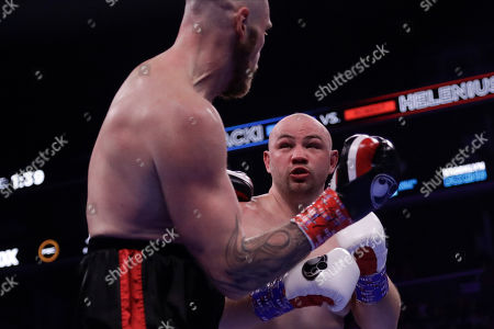 Poland's Adam Kownacki, right, fights Sweden's Robert Helenius during the second round of a heavyweight boxing match, in New York. Helenius stopped Kownacki in the fourth round