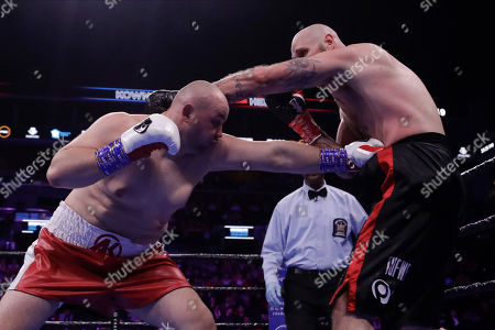 Poland's Adam Kownacki, left, punches Sweden's Robert Helenius during the second round of a heavyweight boxing match, in New York. Helenius stopped Kownacki in the fourth round