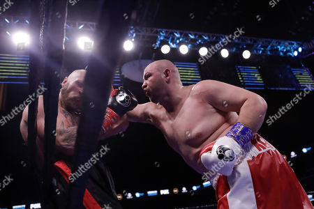 Poland's Adam Kownacki, right, punches Sweden's Robert Helenius during the third round of a heavyweight boxing match, in New York. Helenius stopped Kownacki in the fourth round