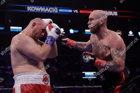 Poland's Adam Kownacki, left, fights Sweden's Robert Helenius during the second round of a heavyweight boxing match, in New York. Helenius stopped Kownacki in the fourth round