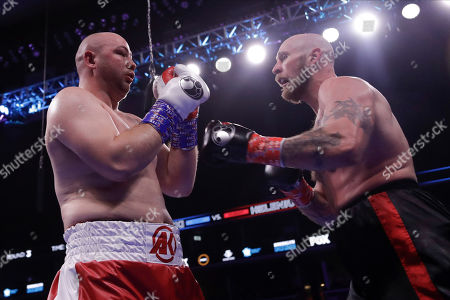 Sweden's Robert Helenius, right, fights Poland's Adam Kownacki during the third round of a heavyweight boxing match, in New York. Helenius stopped Kownacki in the fourth round