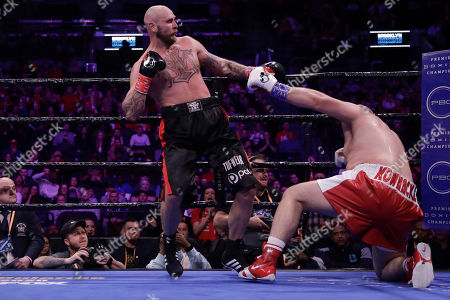 Sweden's Robert Helenius, left, fights Poland's Adam Kownacki during the fourth round of a heavyweight boxing match, in New York. Helenius stopped Kownacki in the fourth round