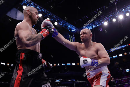 Poland's Adam Kownacki, right, fights Sweden's Robert Helenius during the first round of a heavyweight boxing match, in New York. Helenius stopped Kownacki in the fourth round