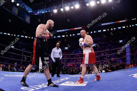 Sweden's Robert Helenius, left, fights Poland's Adam Kownacki during the second round of a heavyweight boxing match, in New York. Helenius stopped Kownacki in the fourth round