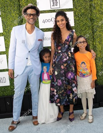 Eric Benet, Amoura Luna Benet, Manuela Testolini and Lucia Bella Benet attends 'A World Of Good' presented by In A Perfect World at the Four Season in Beverly Hills