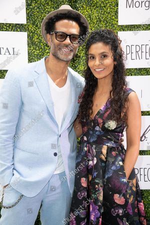 Eric Benet and Manuela Testolini attends 'A World Of Good' presented by In A Perfect World at the Four Season in Beverly Hills