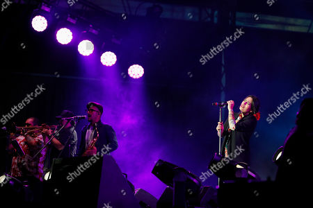 French-Chilean singer Ana Tijoux performs during a concert by female artists on the eve of International Women's Day, in the Zocalo in Mexico City,. Protests against gender violence in Mexico have intensified in recent years amid an increase in killings of women and girls, and women are expected to express their outrage in a march in Mexico City on Sunday