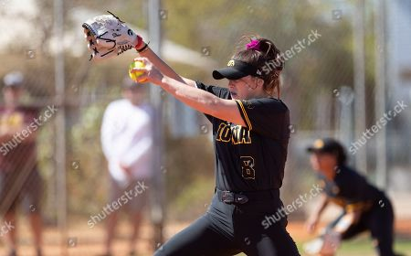Stock Photo of Iowa pitcher Lauren Shaw #8 delivers a pitch during an NCAA softball game, in Madeira Beach, Fla