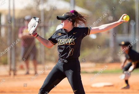 Iowa pitcher Lauren Shaw #8 delivers a pitch during an NCAA softball game, in Madeira Beach, Fla