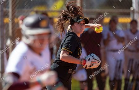Iowa pitcher Lauren Shaw #8 throws out a batter at first during an NCAA softball game, in Madeira Beach, Fla