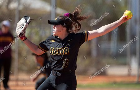 Stock Picture of Iowa pitcher Lauren Shaw #8 delivers a pitch during an NCAA softball game, in Madeira Beach, Fla