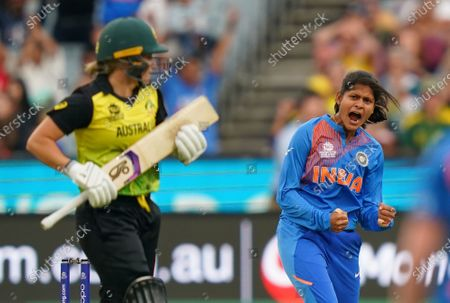 Stock Picture of Radha Yadav (R) of India celebrates after dismissing Alyssa Healy of Australia during the Women's T20 World Cup final match between Australia and India at the MCG in Melbourne,  Australia, 08 March 2020.