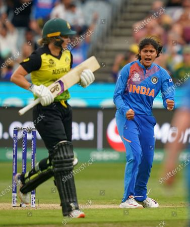 Radha Yadav (R) of India celebrates after dismissing Alyssa Healy of Australia during the Women's T20 World Cup final match between Australia and India at the MCG in Melbourne,  Australia, 08 March 2020.