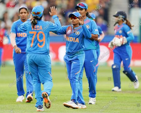 Radha Yadav of India celebrates the wicket of Alyssa Healy of Australia during the Women's T20 World Cup final match between Australia and India at the MCG in Melbourne, Australia, 08 March 2020.