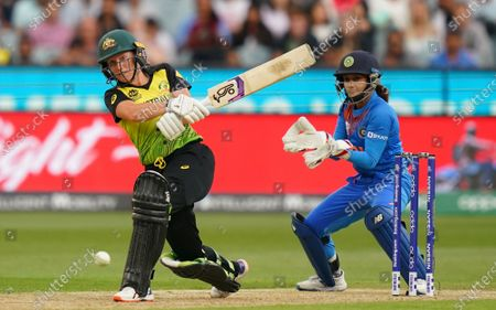 Alyssa Healy (L) of Australia bats during the Women's T20 World Cup final match between Australia and India at the MCG in Melbourne, Australia, 08 March 2020.