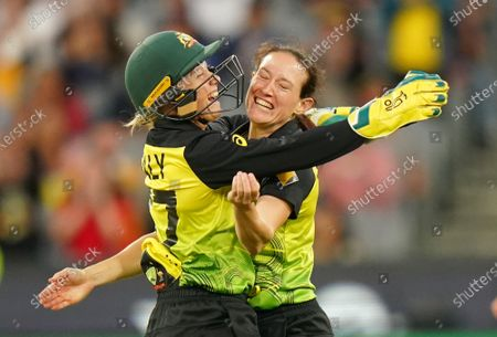 Stock Photo of Megan Schutt (R) of Australia celebrates with 	Alyssa Healy (L) after dismissing Shafali Verma of India during the Women's T20 World Cup final match between Australia and India at the MCG in Melbourne, Australia, 08 March 2020.